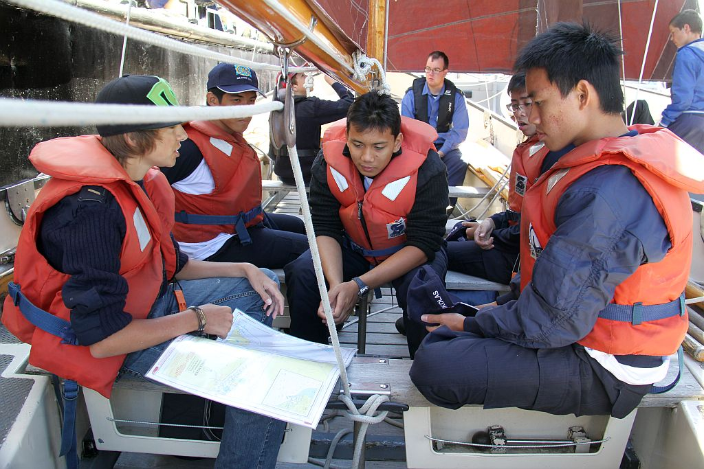 Breefing on board a sailing vessel before the regatta starts between Sea cadets from Indonesia and the Netherlands.